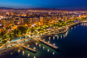Garden Poster Cyprus Republic of Cyprus. Night view of Limassol. Lit at night the streets of Limassol. Top view of Cyprus. Holidays in Cyprus. Piers and quay. A pedestrian pier leads to the sea.