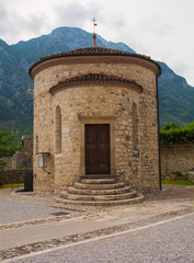 The thirteenth century Cemetery Chapel of Saint Michael in Venzone, Friuli-Venezia Giulia, north east Italy. The church is called the Cappella Cimiteriale di San Michele