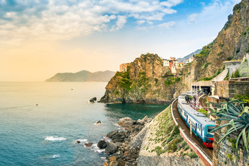 Foto op Aluminium Liguria Manarola, Cinque Terre - train station in famous village with colorful houses on cliff over sea in Cinque Terre