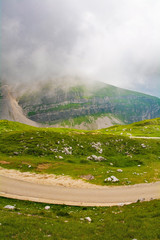 Mangart Saddle in Slovenia in low clouds during the summer. Mangart, also called Mangrt, is the third highest mountain in Slovenia and is situated in the Triglav National Park
