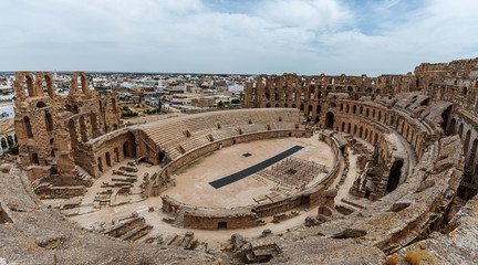 Amphitheatre of El Jem in Tunisia. Amphitheatre is in the modern-day city of El Djem, Tunisia, formerly Thysdrus in the Roman province of Africa