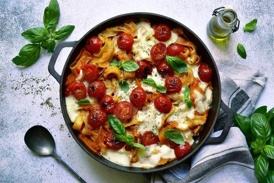 Pasta casserole with tomato and mozzarella.