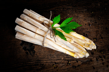 Wall Mural - a white asparagus on a wooden table