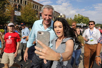 2020 Democratic U.S. presidential candidate and New York City Mayor De Blasio takes a photo with a fairgoer at the Iowa State Fair in Des Moines
