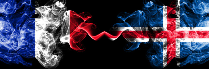 France vs Iceland, Icelandic smoky mystic flags placed side by side. Thick colored silky abstract smoke banner of French and Iceland, Icelandic