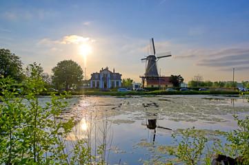Foto auf Leinwand Rotterdam Historic windmills located in Kralingen Lake in Rotterdam, the Netherlands.