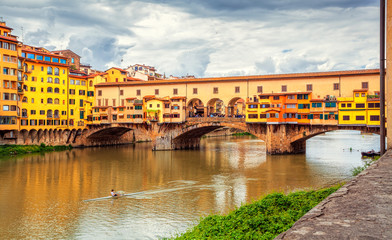 View of medieval stone bridge Ponte Vecchio over Arno river in Florence, Tuscany, Italy. Florence cityscape. Florence architecture and landmark.