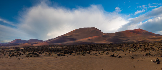 Papiers peints Brun profond national park protecting the landscape formed during the eruption of volcanoes before about 300 years-Timanfaya, Lanzarote, Spain