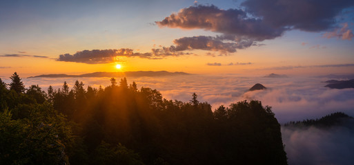 beautiful, spectacular sunrise above the clouds at the top of Three Crowns-Pieniny, Poland