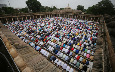 Muslims offer Eid al-Adha prayers at a mosque in Ahmedabad