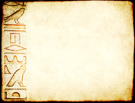 Grunge background with paper texture and detail of ancient egyptian hieroglyphs