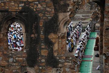 Muslims offer Eid al-Adha prayers at the ruins of Feroz Shah Kotla mosque in New Delhi