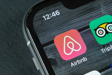 Sankt-Petersburg, Russia, April 10, 2018: Airbnb application icon on Apple iPhone X screen close-up. Airbnb app icon. Airbnb.com is online website for booking rooms. social media network.