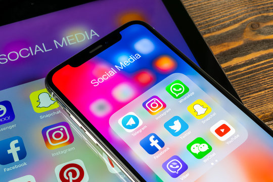 Sankt-Petersburg, Russia, May 30 2018: Apple iPad and iPhone X with icons of social media facebook, instagram, twitter, snapchat application on screen. Social media icons. Social network. Social media