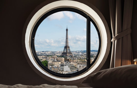 Looking through window, Eiffel tower famous landmark in Paris, France. Vacation in Europe