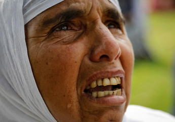 A Kashmiri woman cries after offering the Eid-al-Adha prayers at a mosque during restrictions after the scrapping of the special constitutional status for Kashmir by the Indian government, in Srinagar