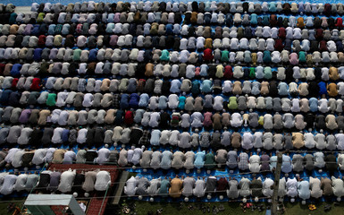 Kashmiris offer Eid-al-Adha prayers at a mosque during restrictions after the scrapping of the special constitutional status for Kashmir by the Indian government, in Srinagar
