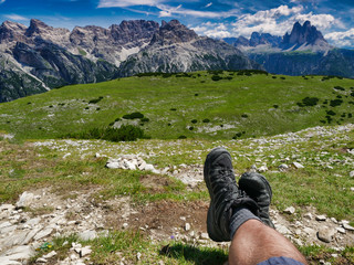 hiker enjoying rest and amazing panoramic view of dolomites three peaks of lavaredo italy
