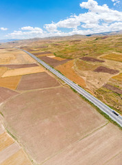 Aerial view of fields and cliffs close lake Van, Turkey. Roads along the lake