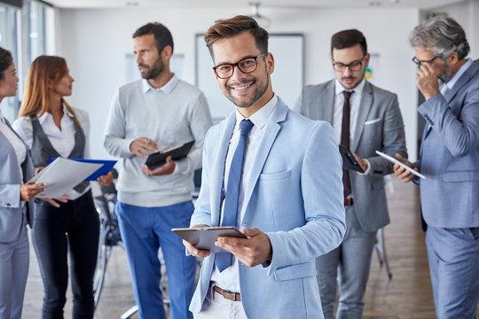 businessman office portrait corporate meeting tablet