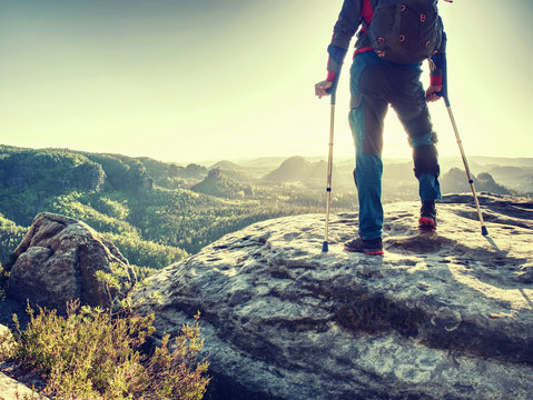 Man Suffering Leg Injury on Mountain Hike. Disabled hiker