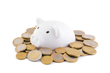 White piggy bank with euro coins on white background