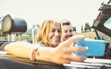 Couple driving on a convertible car and having fun