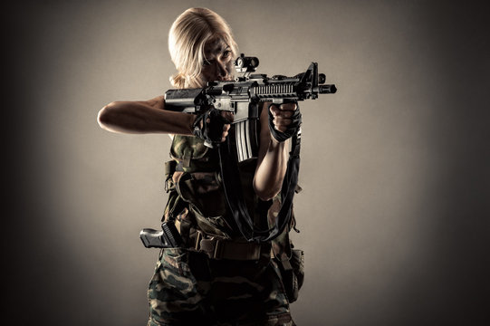 armed woman soldier with guns in hands