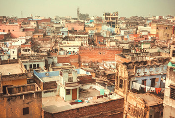 Historical indian city Varanasi, view over roofs of the poor brick buildings, India
