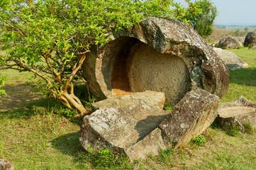 Broken ancient stone jars in a Plain of Jars (Site #1) near Phonsavan, Xienghouang province, Laos.