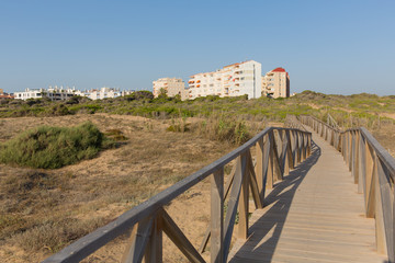 Wooden pedestrian bridge pathway from beach to holiday apartments Torre la Mata Costa Blanca Spain