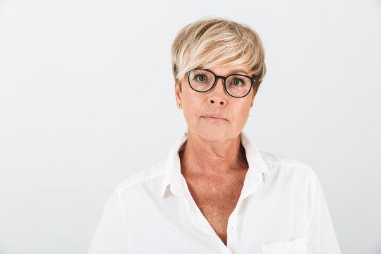Portrait of caucasian adult woman wearing eyeglasses looking at camera