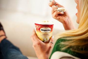 Woman Eating Pint Of Haagen-Dazs Vanilla Ice Cream