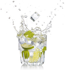 Wall Mural - ice cube falling into a mojito isolated on white background