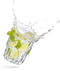 Wall Mural - glass of flying and splashing mojito isolated on white