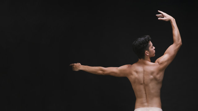 Graceful dancer with muscular back