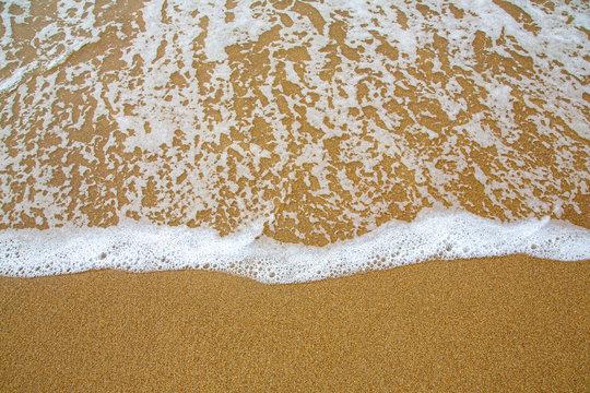 Sea foam on Sand Beach in Acadia, Maine, USA