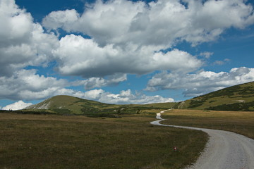 Nice clouds above the trail to Lurgbauerhütte on Schneealpe in Lower Austria, Europe