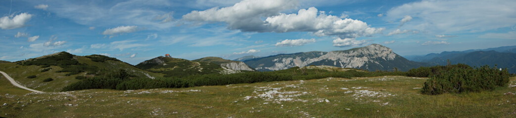 Panoramic view of the Schneealpenhaus and the Heukuppe, the highest mountain of Rax in Lower Austria, Europe