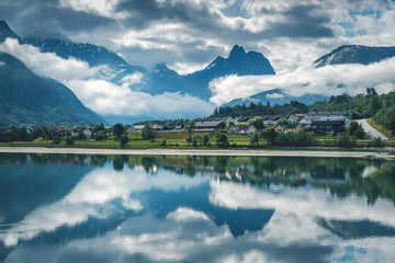 Wall Mural - Beautiful landscape, the coast of the Andalsnes Fjord in Norway, clouds and mountains are reflected in clear water