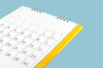 close up cardboard desk calendar with days and date isolated on blue background, reminder monthly business planning or meeting deadline Wall mural