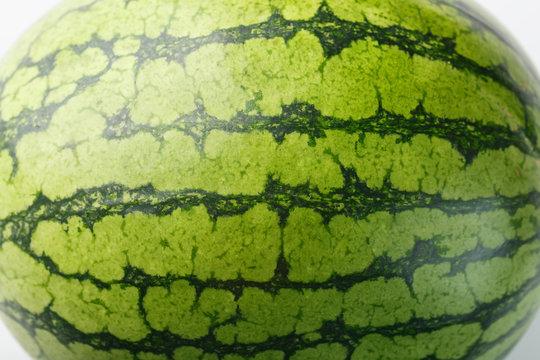 Striped peel of ripe watermelon. Watermelon peel ka background in full screen