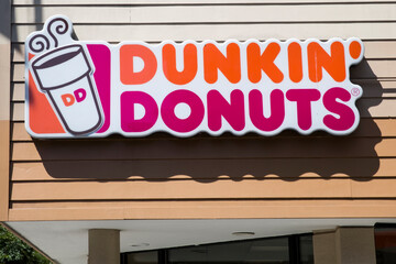 Detail of the Dunkin Donuts store in New York. It is an American global donut company and coffeehouse founded at 1950.