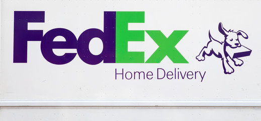 Detail from FedEx truck in New York, USA. FedEx Corporation is an American multinational courier delivery services company from Memphis, Tennessee, founded at 1971.
