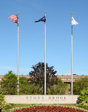 STONY BROOK, NY - MAY 24, 2015: Stony Brook University Main Entrance. The flags at the SUNY institution at Stony Brook, Long Island, New York.