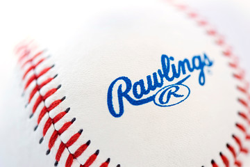 Closeup view at the Rawlings baseball ball. Rawlings is a sports equipment company based in the United States founded in 1887.