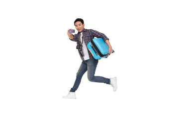 Young Asian man jumping with suitcase and credit card isolated on white background, Traveling and tour concept