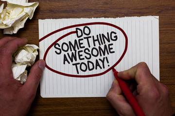 Text sign showing Do Something Awesome Today. Conceptual photo Make an incredible action motivate yourself Hand hold paper lob and red pen red circled black words on white paper