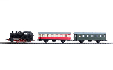 Model of a steam locomotive and passenger cars on rails on a white background