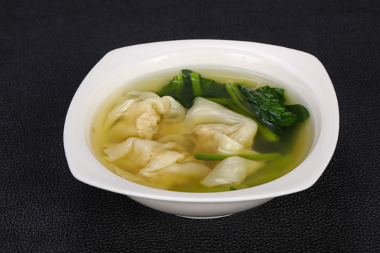 Asian traditional Wonton soup with herbs